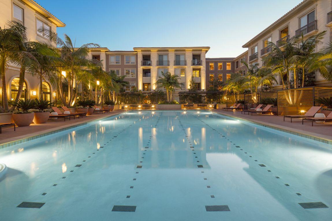 Exterior view of resort pool at Malibu - Villas Playa Vista Apartment Homes in Los Angeles, CA.