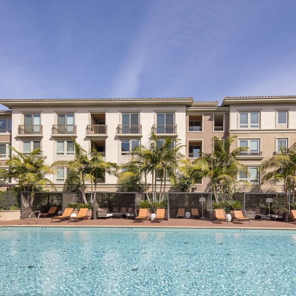 Exterior view of resort pool at Malibu - Villas Playa Vista Apartment Homes in Los Angeles, CA.