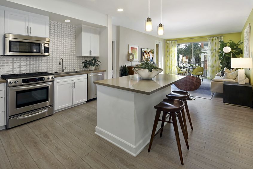 Interior view kitchen and living room at Malibu - Villas Playa Vista Apartment Homes in Los Angeles, CA.