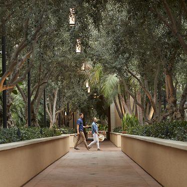 Exterior view of couple walking at Malibu - Villas at Playa Vista Apartment Homes in Playa Vista, CA.