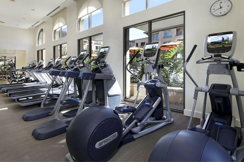 Interior view of fitness center at Montecito - Villas at Playa Vista Apartment Homes in Los Angeles, CA.