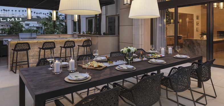Exterior view of alfresco terrace at Montecito - Villas at Playa Vista Apartment Homes in Los Angeles, CA.