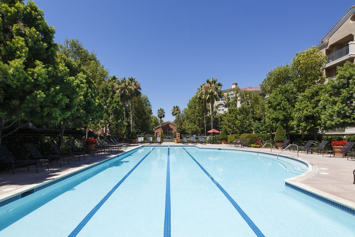 Exterior view of pool at Cherry Orchard Apartment Homes in Sunnyvale, CA.