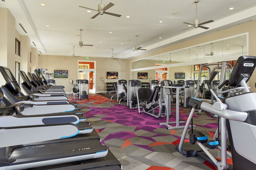 Interior view of Fitness Center at Crescent Village Apartment Homes in San Jose, CA.