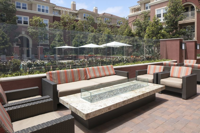 Exterior view of courtyard and lounge area at Franklin Street Apartment Homes in Redwood City, CA.