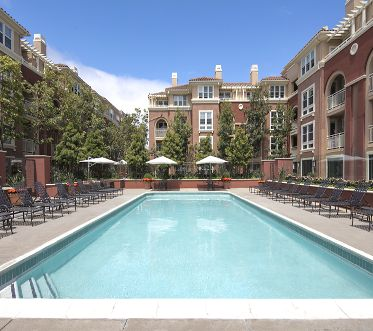 Exterior view of pool at Franklin Street Apartment Homes in Redwood City, CA.