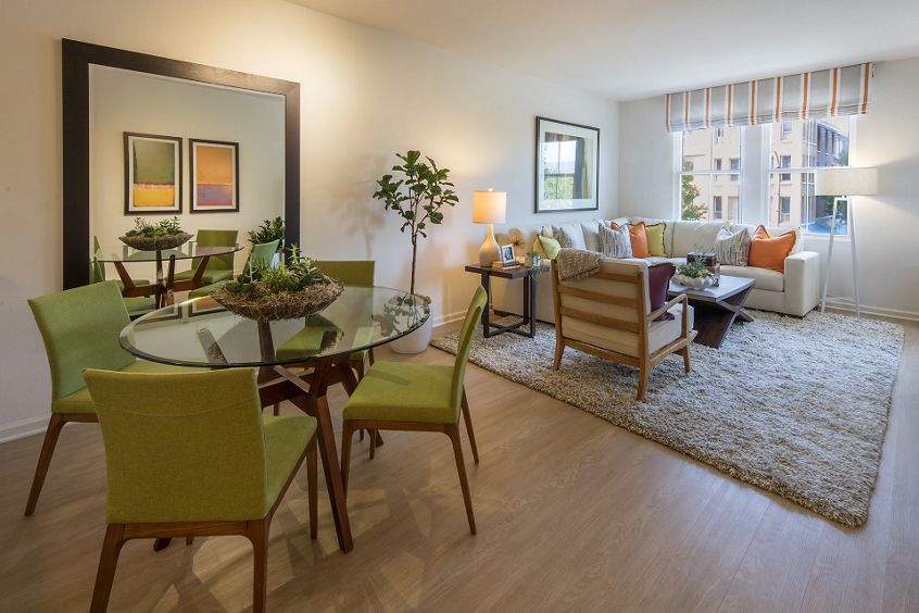 Interior view of dining and living room at Franklin Street Apartment Homes in Redwood City, CA.