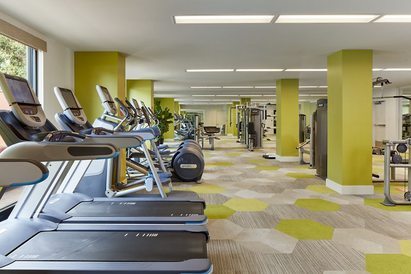 Interior view of fitness center at Franklin Street Apartment Homes in Redwood City, CA.