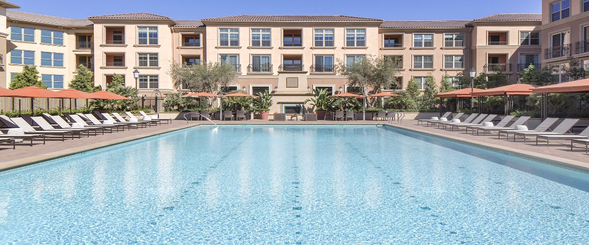 Exterior view of a pool at Monticello Apartment Homes in Santa Clara, CA.