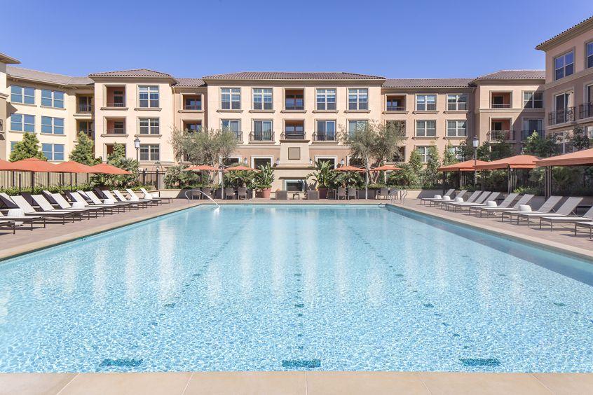 Exterior view of a pool at Monticello Apartment Homes in Santa Clara, CA.