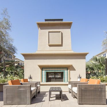 Exterior view of a fireplace at Monticello Apartment Homes in Santa Clara, CA.