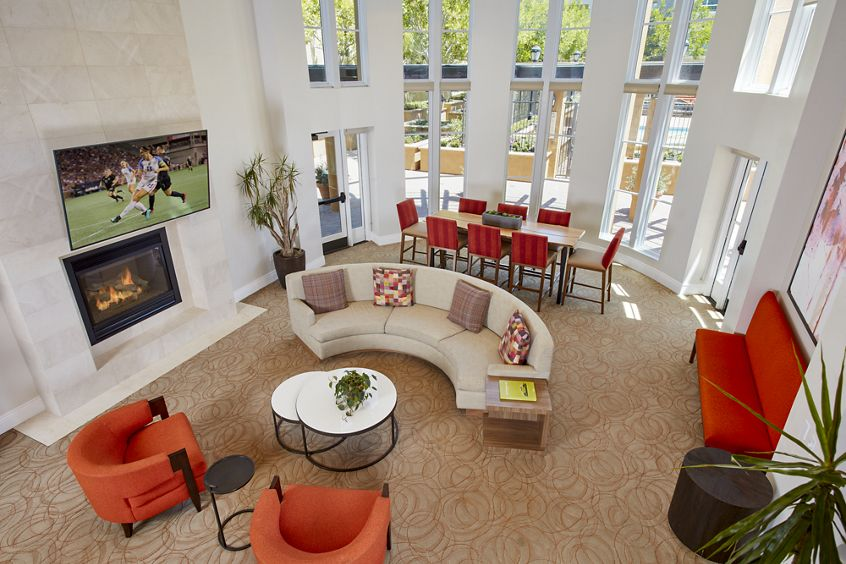 Interior view of clubhouse with fireplace at The Cypress at North Park Apartment Homes in San Jose, CA.