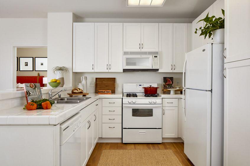 Interior view of kitchen at The Laurels at North Park Apartment Homes in San Jose, CA.