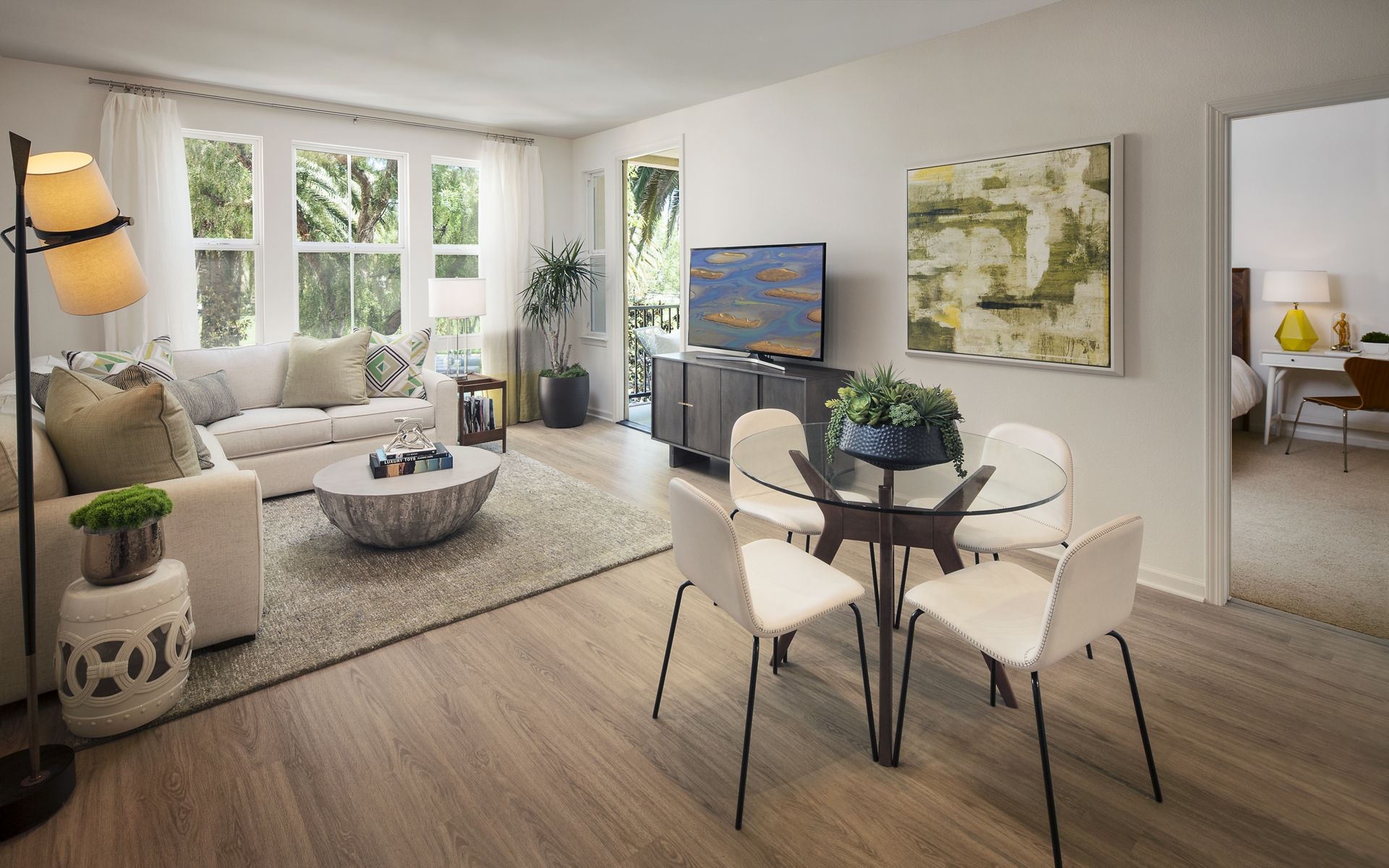 Interior view of a dining space and living room at The Oaks at North Park Apartment Homes in San Jose, CA.