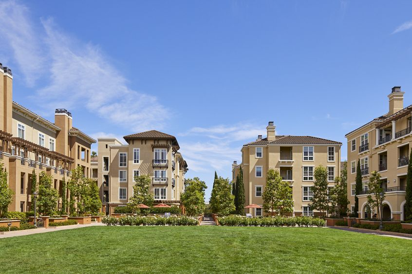 Exterior view of the courtyard at The Pines at North Park Apartment Homes in San Jose, CA.