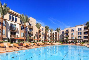 Exterior view of pool at River View Apartment Homes in San Jose, CA.