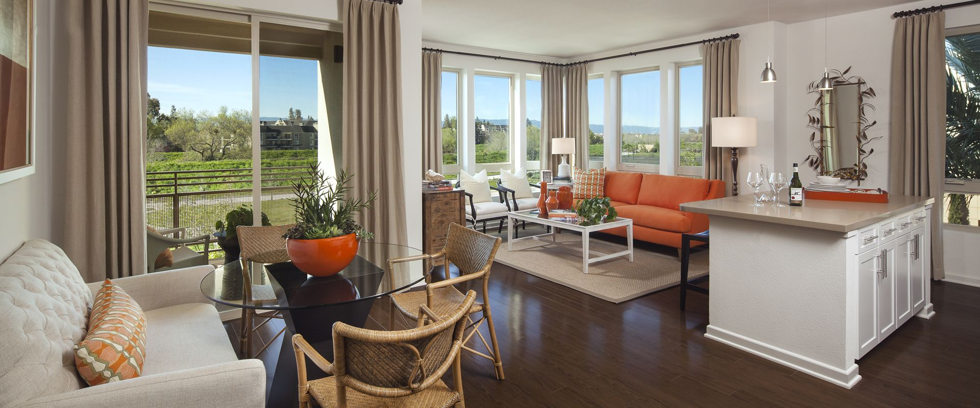 Interior view of living room and dining room at River View Apartment Homes in San Jose, CA.