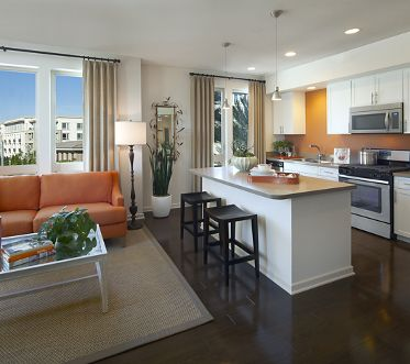 Interior view of living room and kitchen at River View Apartment Homes in San Jose, CA.