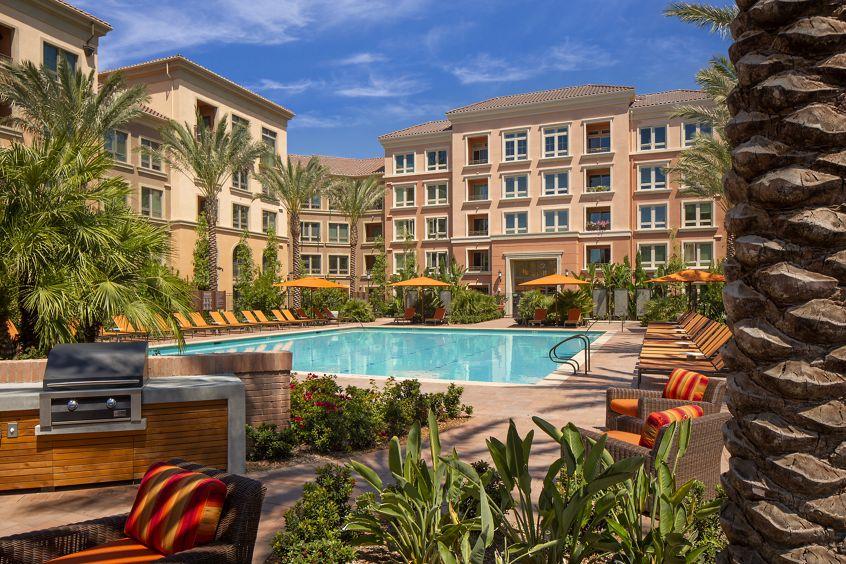Exterior pool view at Santa Clara Square Apartment Homes in Santa Clara, CA.
