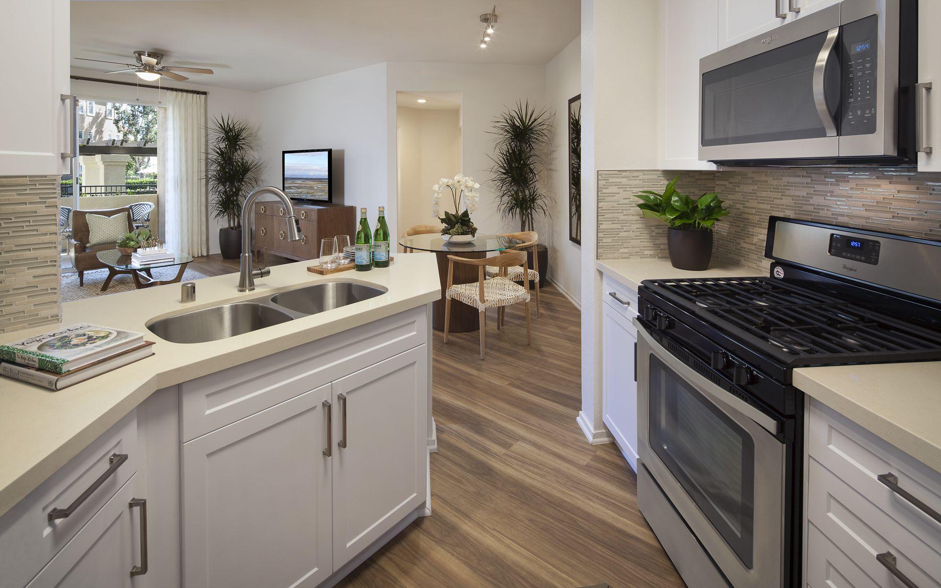 Interior view of a kitchen at Vista Bella Apartment Homes in Aliso Viejo, CA.