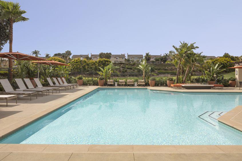 Exterior view of a pool at Vista Bella Apartment Homes in Aliso Viejo, CA.