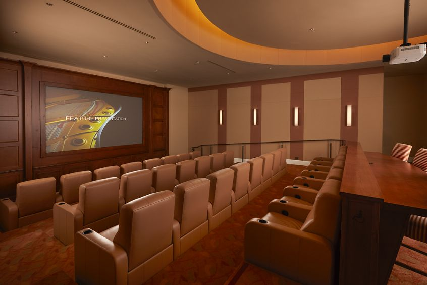 Interior view of movie theater at The Enclave at South Coast Apartment Homes in Costa Mesa, CA.