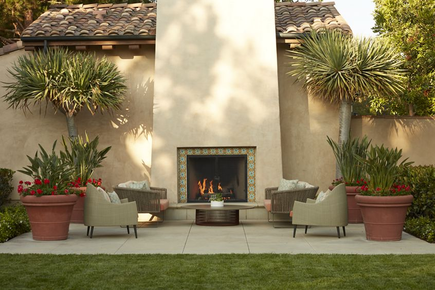 Exterior view of outdoor fireplace at The Enclave at South Coast Apartment Homes in Costa Mesa, CA.