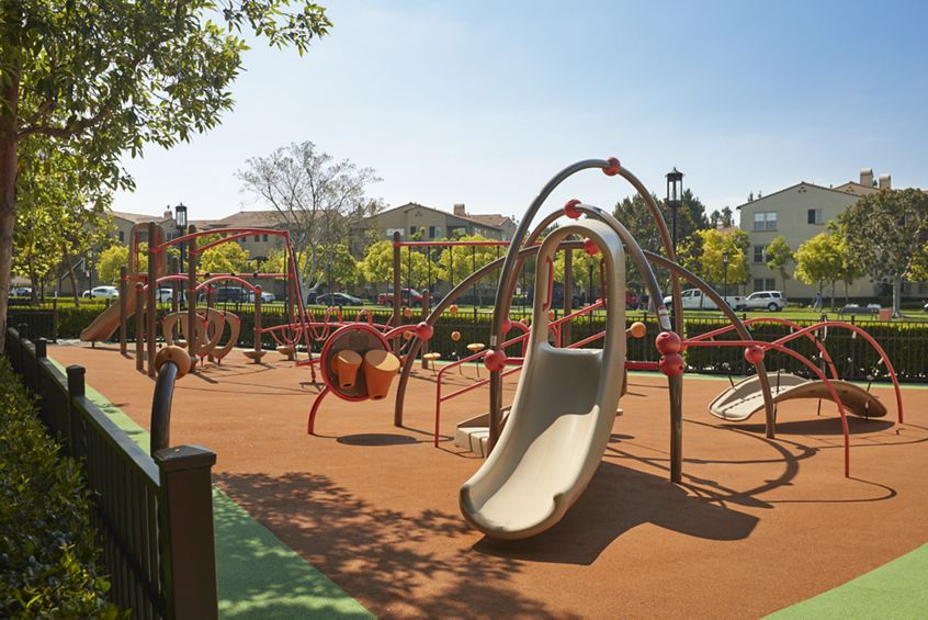 View of Outdoor Playground at The Enclave at South Coast Apartment Homes in Costa Mesa, CA.