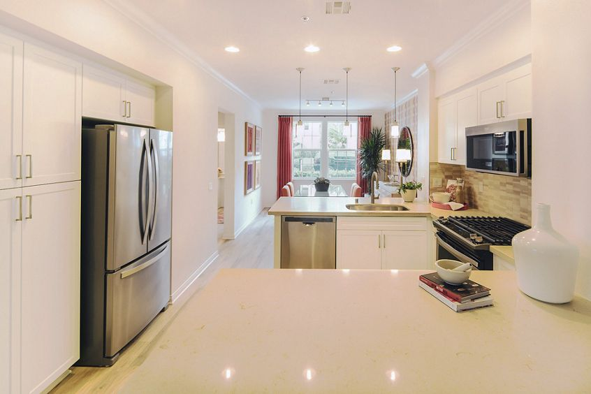 Interior view of kitchen at Anacapa Apartment Homes in Irvine, CA.
