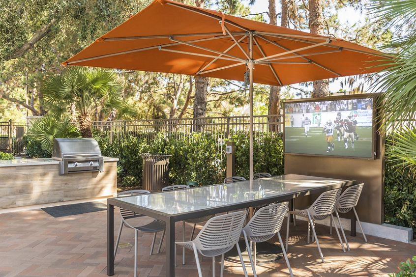 View of outdoor patio and BBQ area at Anacapa Apartment Homes in Irvine, CA.