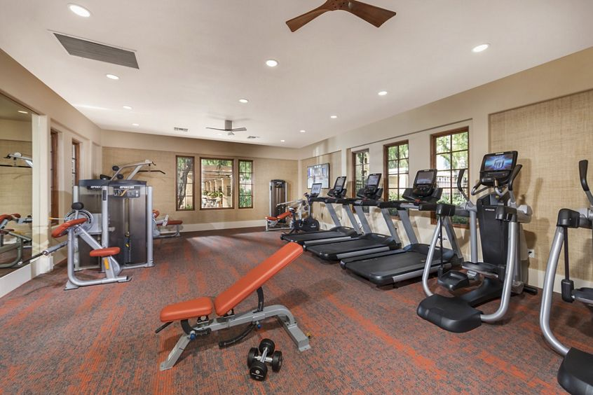 Interior view of fitness center at Anacapa Apartment Homes in Irvine, CA.