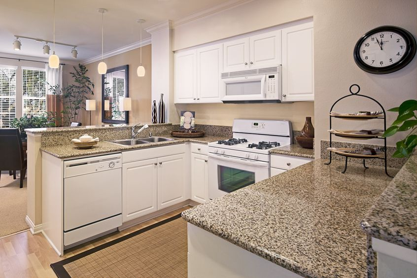 Interior view of a kitchen at Anacapa Apartment Homes in Irvine, CA.