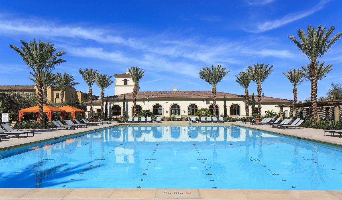 Exterior view of pool at Avella Apartment Homes in Irvine, CA.