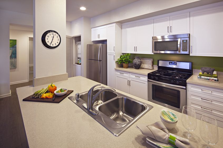 Interior view of kitchen at Avella Apartment Homes in Irvine, CA.