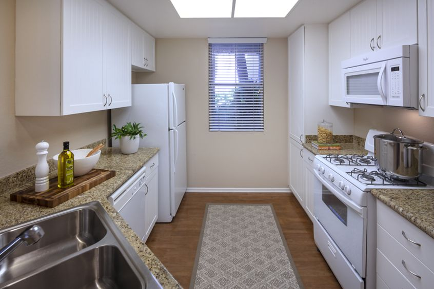 Interior view of kitchen at Brittany Apartment Homes in Irvine, CA.
