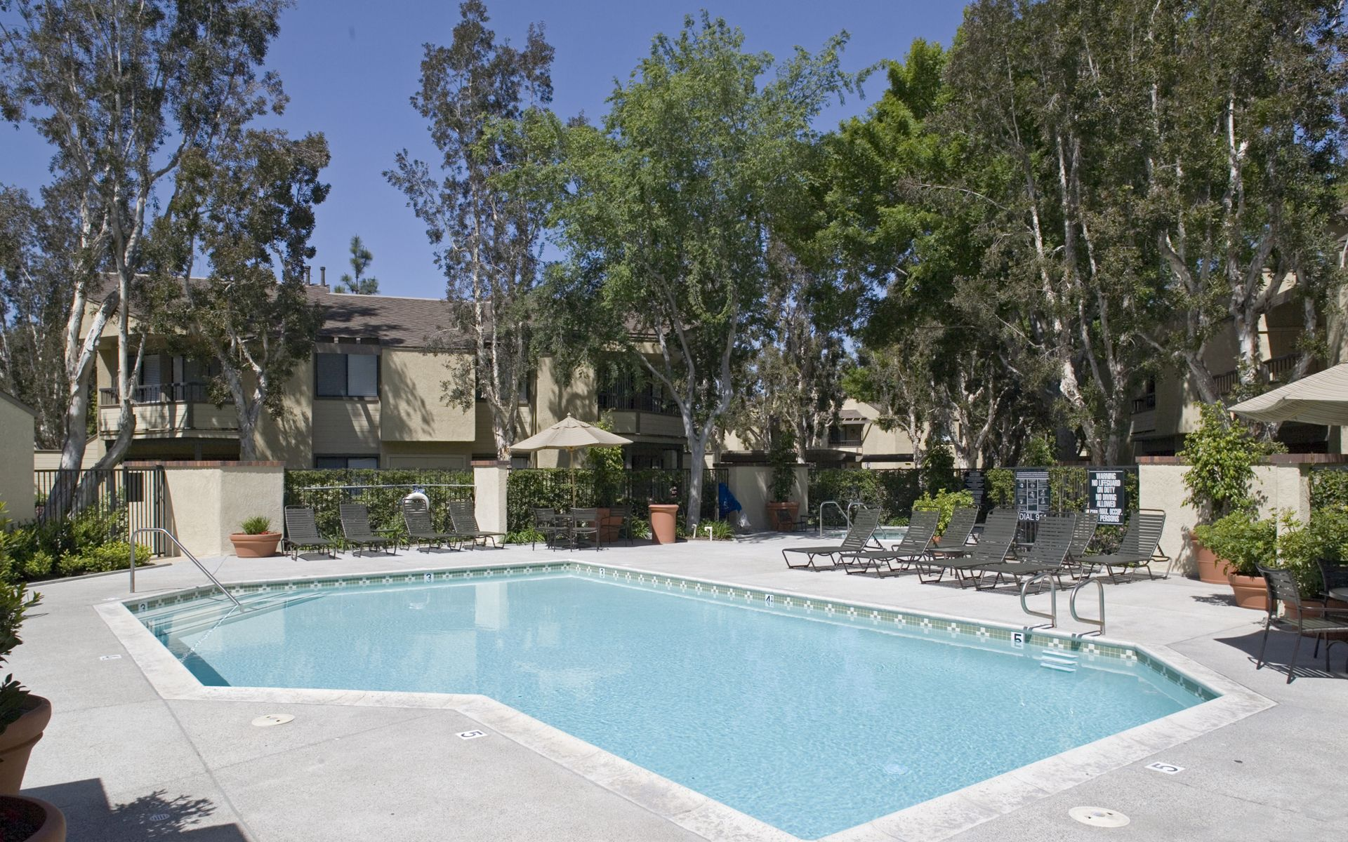 Pool view at Cedar Creek Apartment Homes in Irvine, CA.