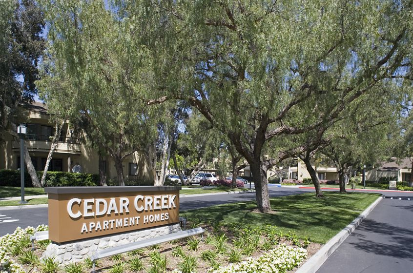 Exterior view of entrance at Cedar Creek Apartment Homes in Irvine, CA.