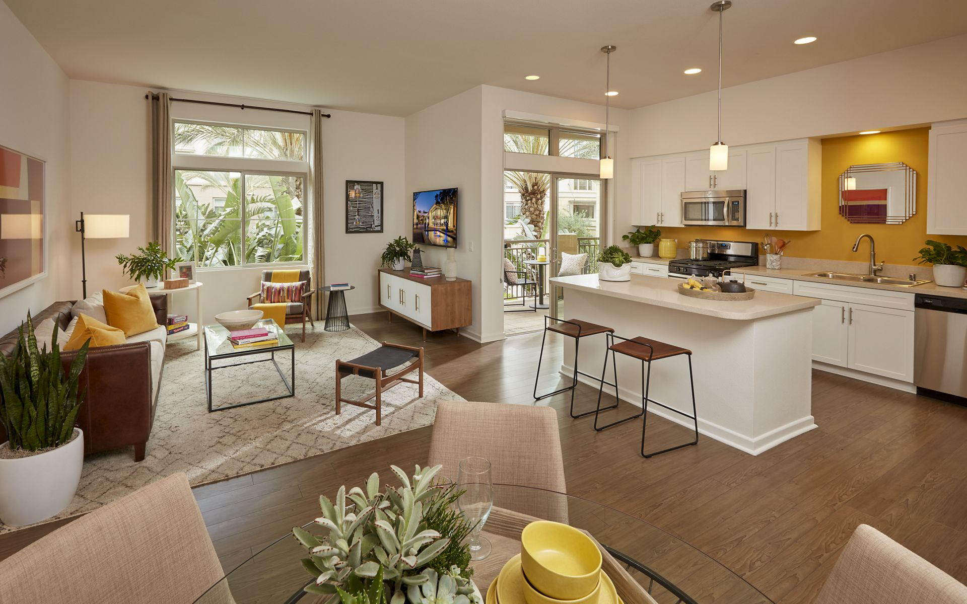 Interior view of living room and kitchen at Centerpointe at Irvine Spectrum Apartment Homes in Irvine, CA.