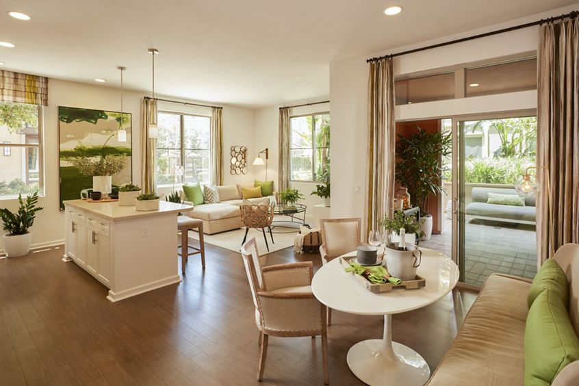Interior view of living room and dining room at Centerpointe at Irvine Spectrum Apartment Homes in Irvine, CA.