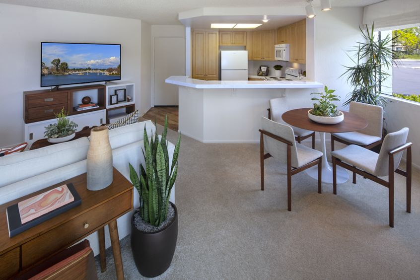 Interior view of dining room and kitchen at Cross Creek Apartment Homes in Irvine, CA.