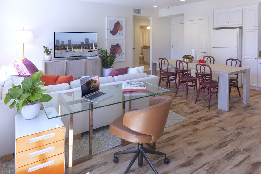 Interior view of living room and dining room at Murano Apartment Homes at Cypress Village in Irvine, CA.