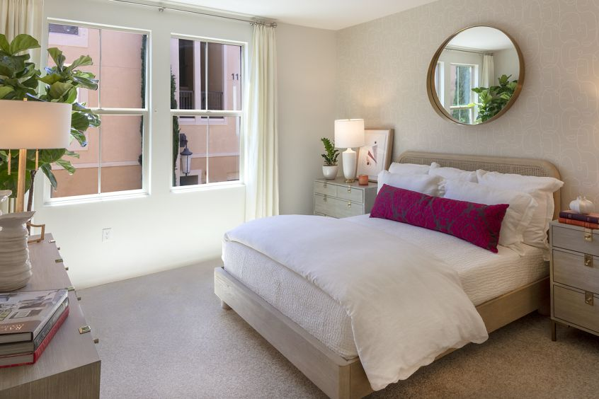 Interior view of bedroom at Murano Apartment Homes at Cypress Village in Irvine, CA.
