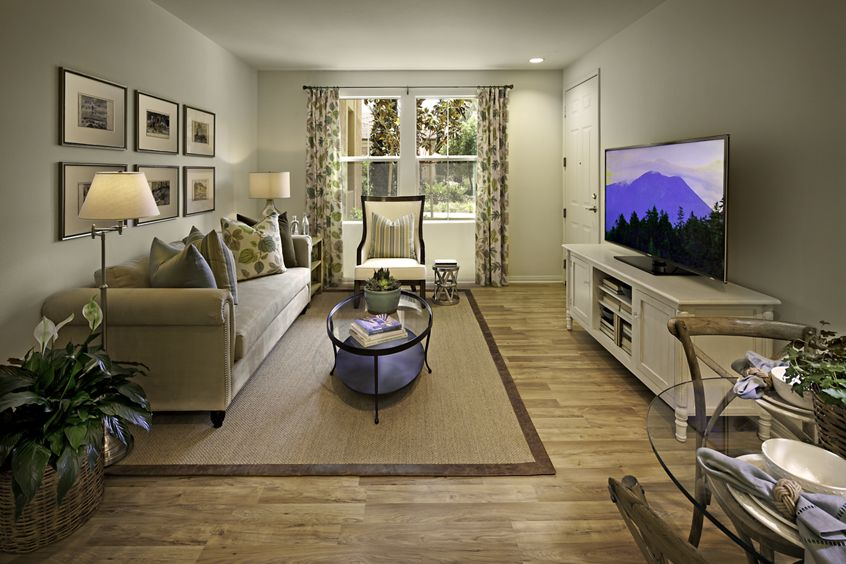 Interior view of living room at Murano Apartment Homes at Cypress Village in Irvine, CA.