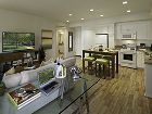 Interior view of living room and kitchen at Murano Apartment Homes at Cypress Village in Irvine, CA.
