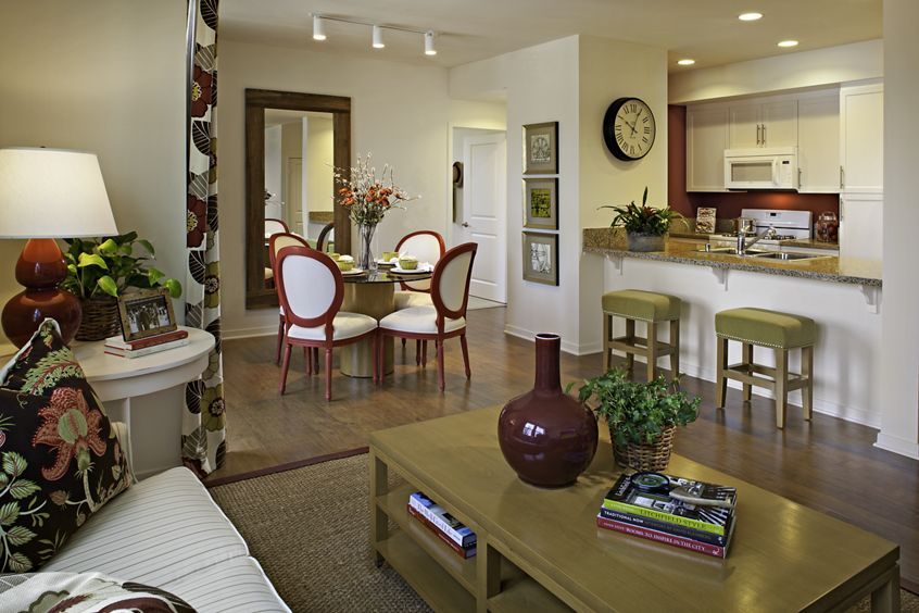 Interior view of dining room and kitchen at Umbria Apartment Homes at Cypress Village in Irvine, CA.