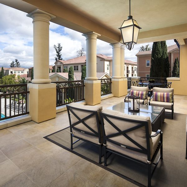 View of clubhouse balcony at Umbria Apartment Homes at Cypress Village in Irvine, CA.