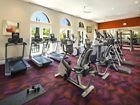 Interior view of fitness center at Umbria Apartment Homes at Cypress Village in Irvine, CA.