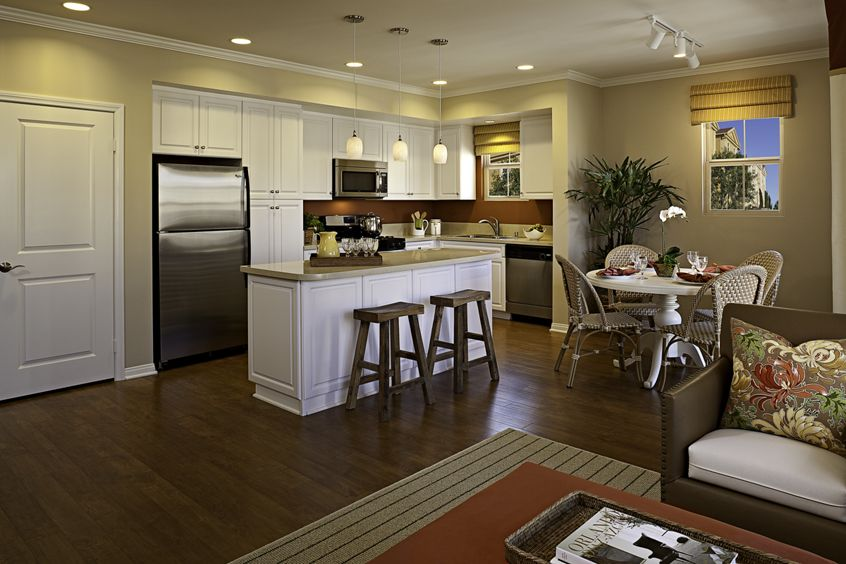 Interior view of living room and kitchen at Veneto Apartment Homes at Cypress Village in Irvine, CA.