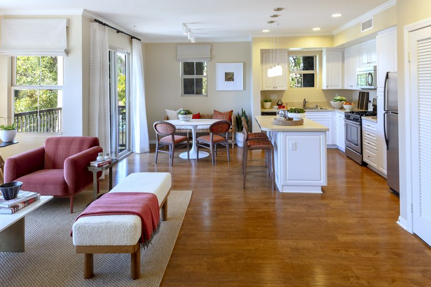 Interior view of kitchen, dining room and living room at Veneto Apartment Homes at Cypress Village in Irvine, CA.