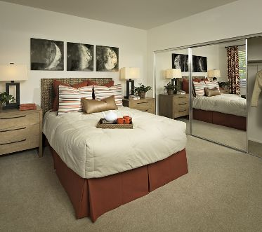 Interior view of bedroom at Estancia Apartment Homes in Irvine, CA.
